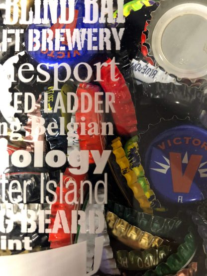 Close Up shot of this custom laser engraved shadow box beer cap collector. Featuring state craft beer breweries
